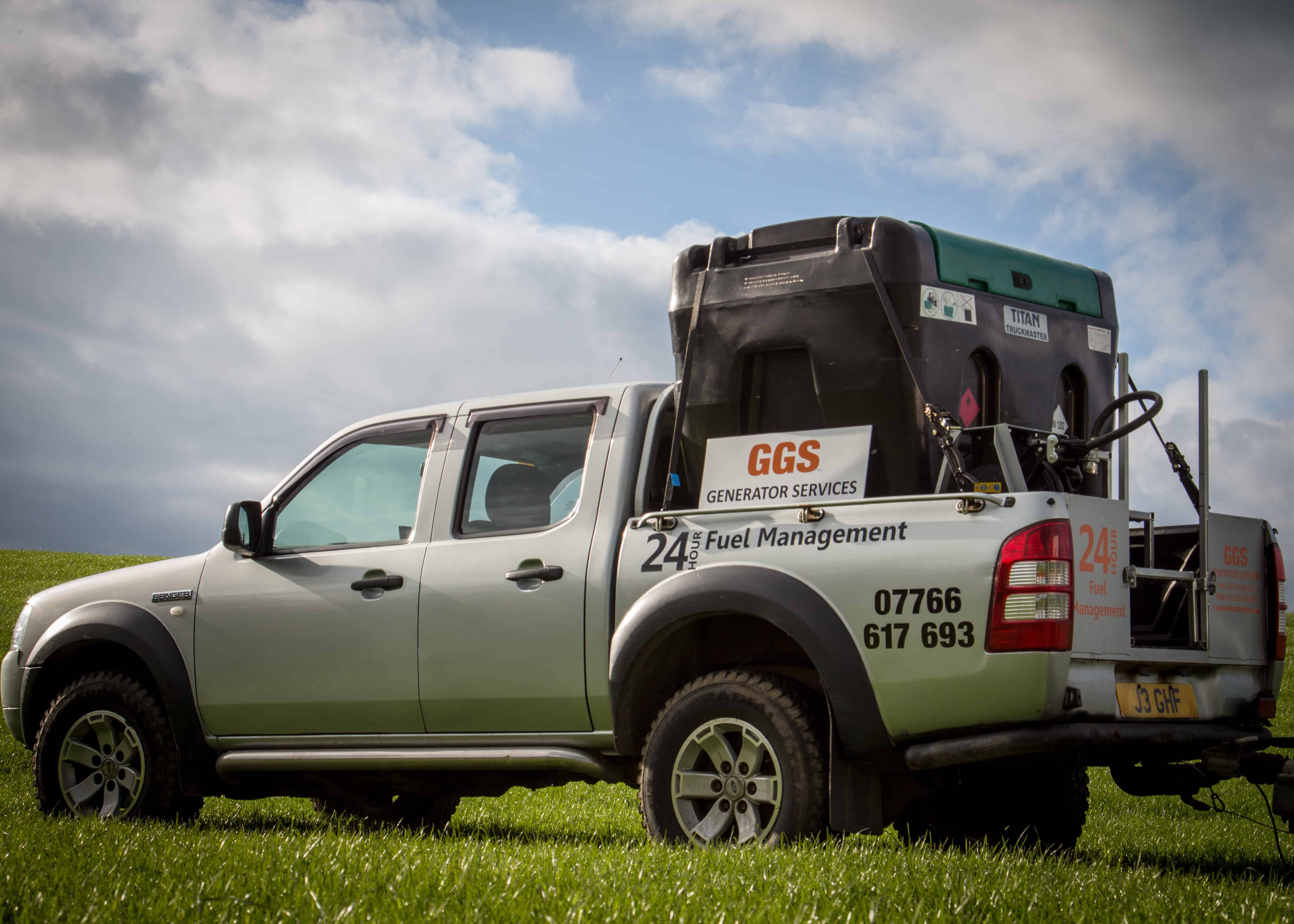 Generator hire Scotland van pulling a trailer